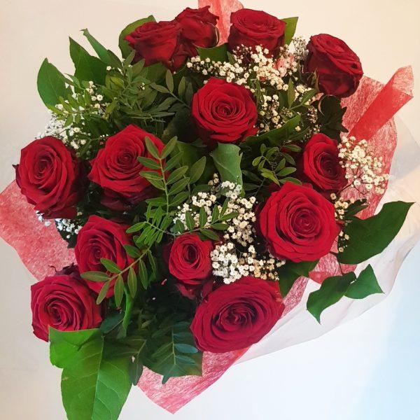 A bouquet of a dozen Red Naomi Roses